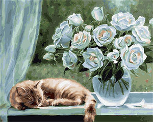 Cat Sleeps Beside Glass Vase