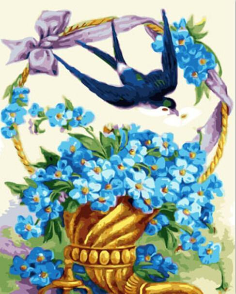 Adorable Robin with Basket of Blue Flowers