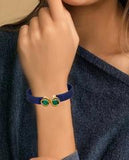 Dual Emerald in a Blue Leather Bracelet in hand