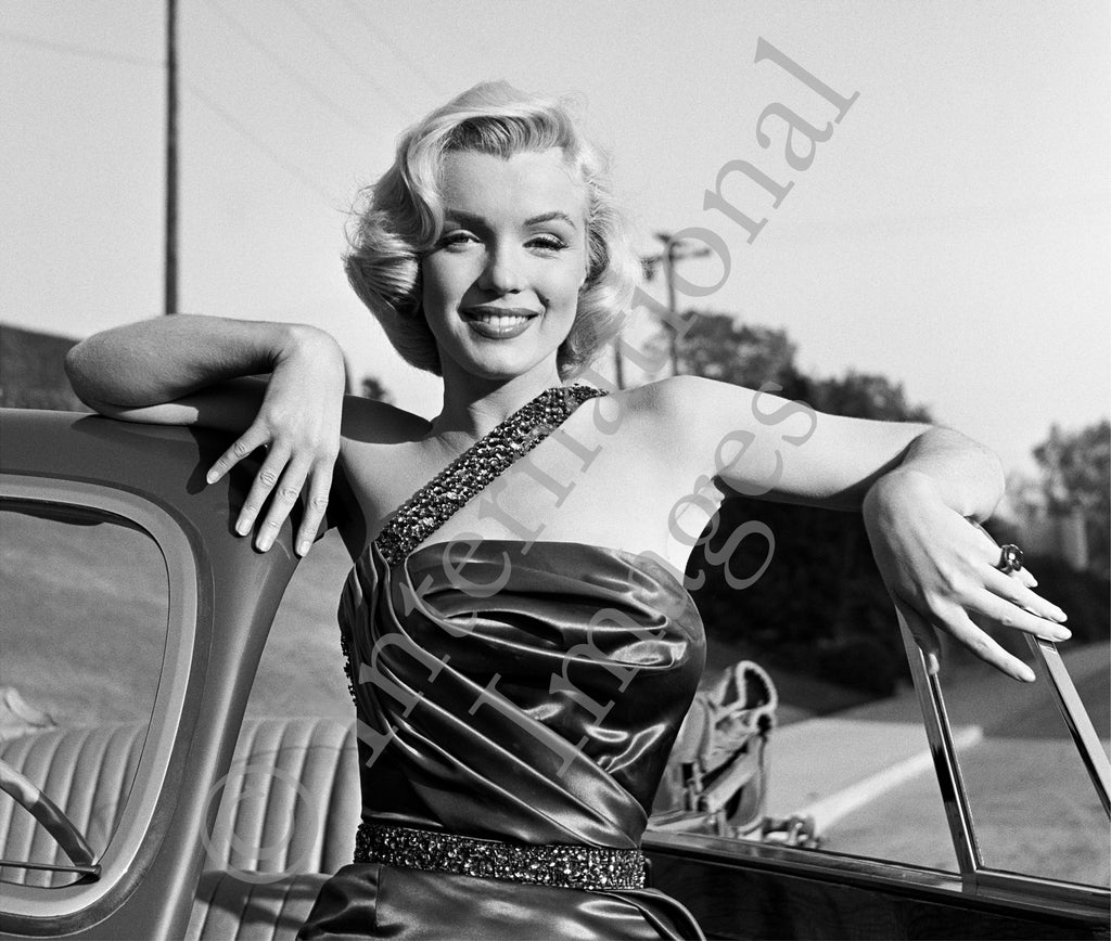 Classic Marilyn Monroe pose by car in How to Marry a Millionaire dress (0004)
