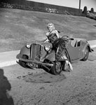 Marilyn Monroe sprawls across Worth's car (0005)