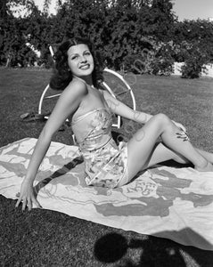 Early Rita Hayworth sunning on towel (0006)