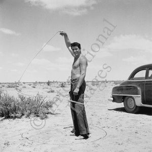 Rock Hudson with lasso on the set of Giant (0013)