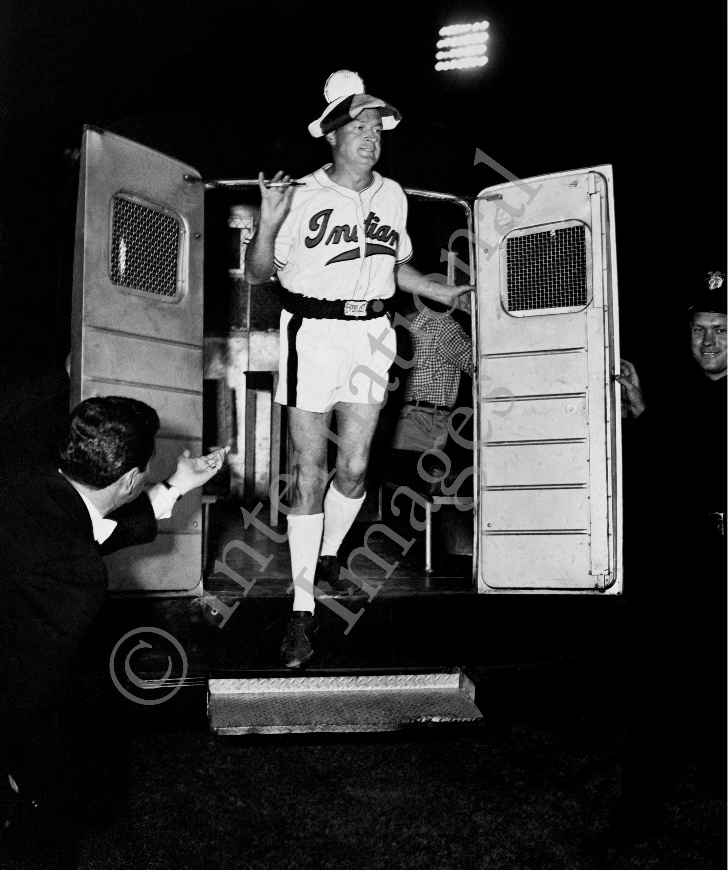 Bob Hope exits trailer with shorts and Cleveland Indian baseball shirt (0018)