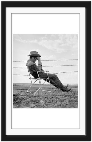 James Dean sits behind barbed wire fence on the set of Giant (0026)