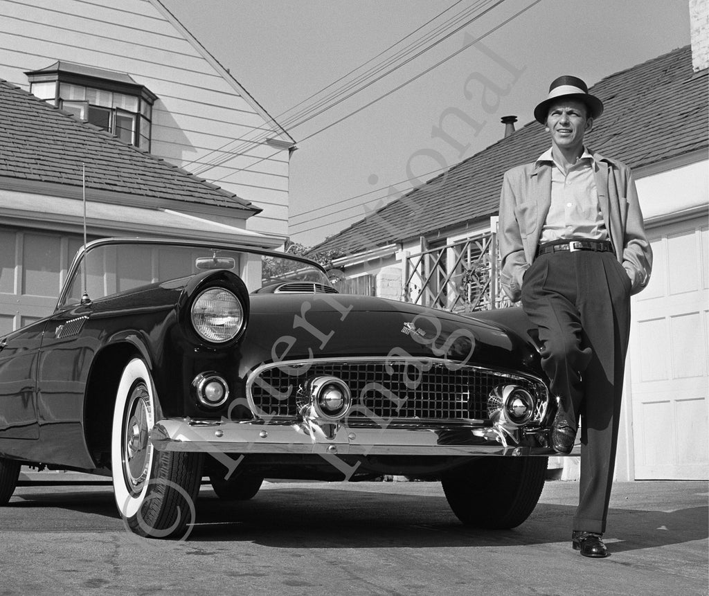 Frank Sinatra near trailer standing with his 50's Ford convertible (0028)