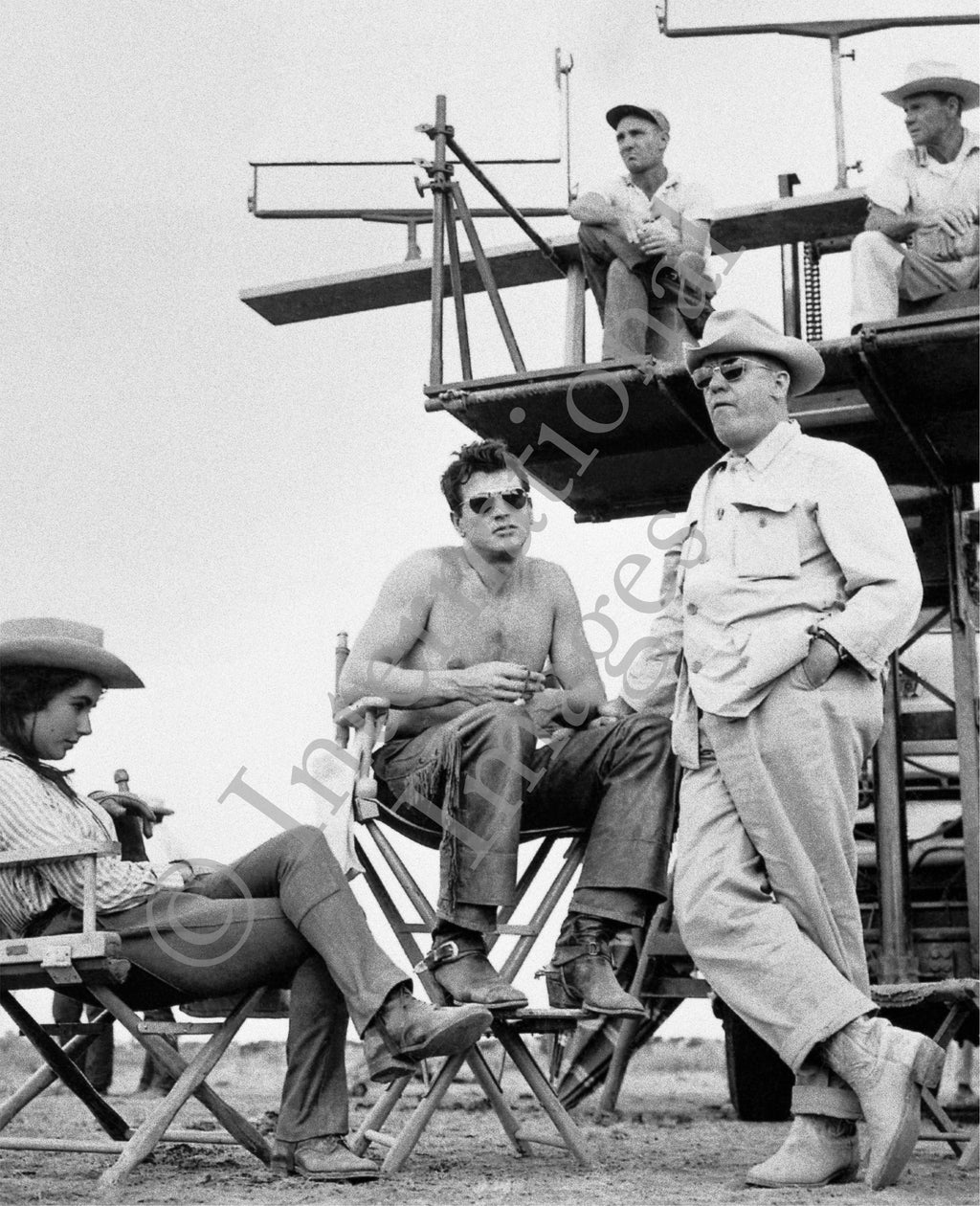 Shirtless Rock Hudson on the set of Giant with Elizabeth Taylor and Sir George Stevens (0029)