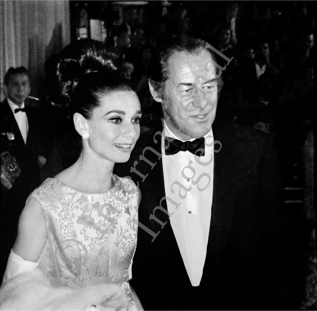 Audrey Hepburn and Rex Harrison at a black tie event (0036)