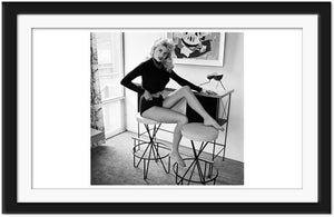 Jayne Mansfield poses on a bar stool (0037)