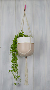 blush and cream plant hanger with a small Common House Studio planter pot in a blush tone with a gold stripe