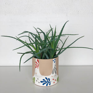 leaf print boob tank planter with light skin tone and aloe plant