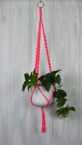 Neon Pink plant hanger with a white hand painted planter