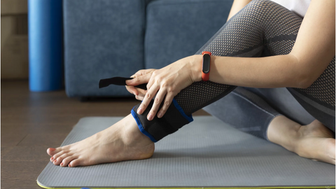 A Woman Using Ankle Weights