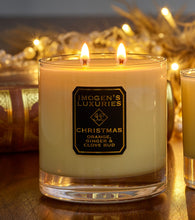 Christmas Home Candle burning. 325g Soy wax fragranced with Orange, Cinnamon, Clove andGinger Essential oils. Handmade in England by a mother and daughter team.