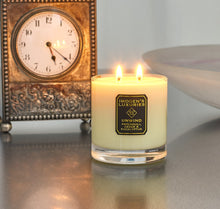 Unwind Home Candle burning: Fragranced with Patchouli, Cedar & Eucalyptus Essential Oils. Handpoured with 320g natural wax. £24