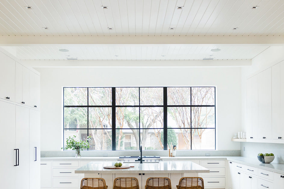 Kitchen with recessed lighting providing ambient or general light.