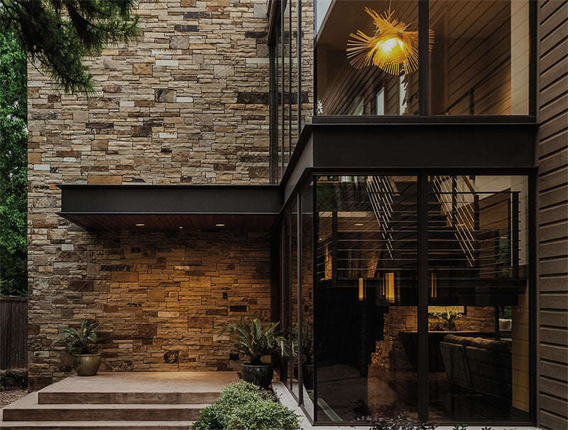 The outside of this home is well-lit with recessed lights at the entry for safety and security.