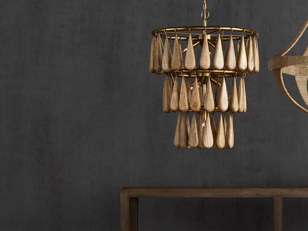 Currey & Company's Savoiardi Chandelier, featuring natural wood drops and brass hardware.
