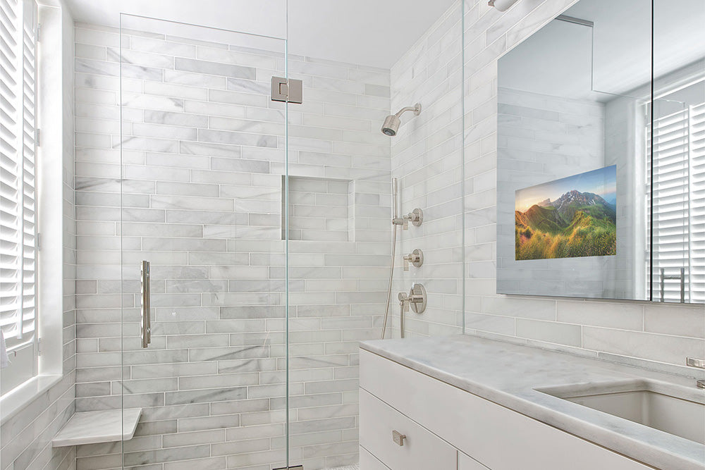 A contemporary bathroom with a Seura Vanishing Vanity TV mirror