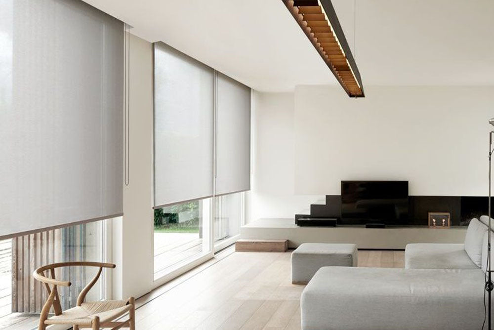 Living room roller shades with shade pockets.
