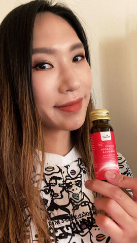 Monica with Revive, the red bottle