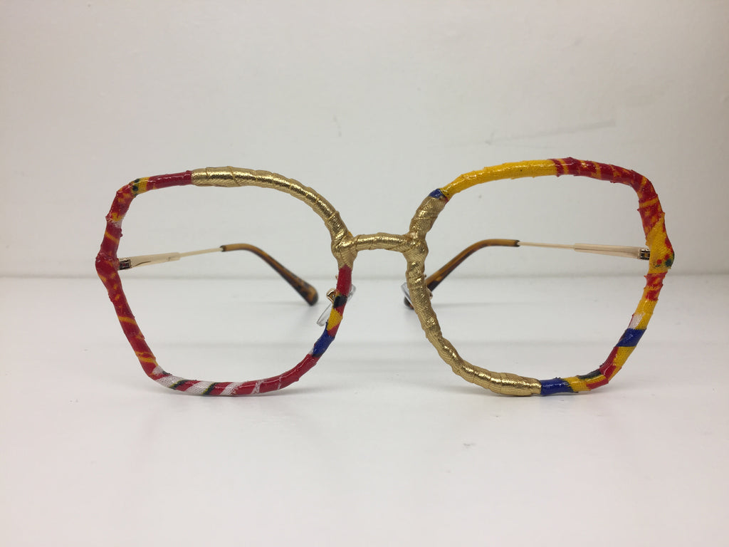 Khandie Woo Lensless wide eyed frame Kente and gold