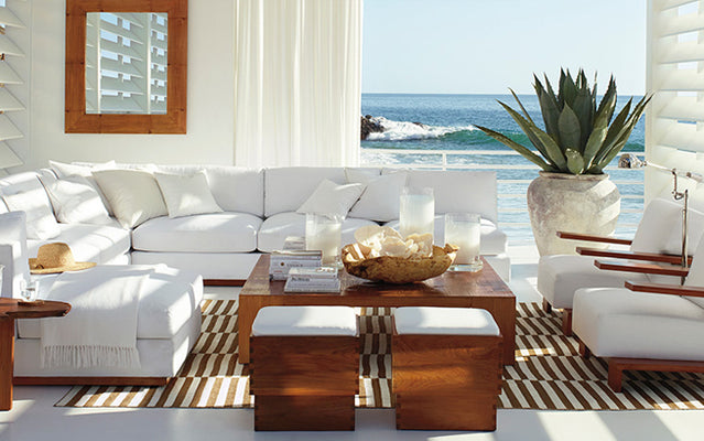 Coastal fabric white couches and chairs with white roman shades