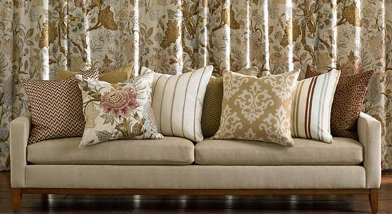 Kravet Fabric, A kravet couch with throw pillows all using elegant kravet patterns.