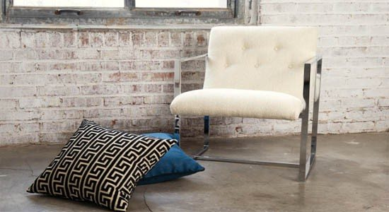 nate berkus fabrics white black blue pattern cushions chair bricks walll