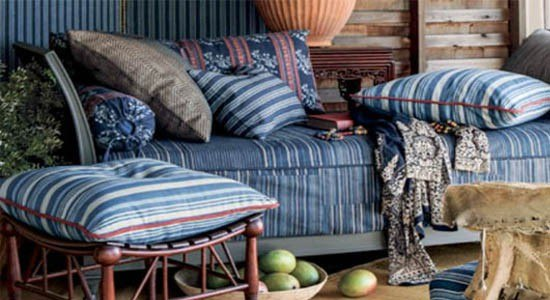 Lounging area with a chair and throw pillows upholstered using Ralph Lauren fabrics