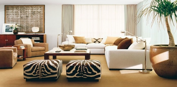 Living room with white sofa and zebra ottomans by Ralph Lauren