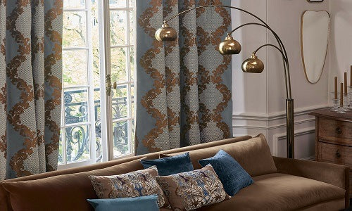 Throw pillows and drapes constructed using Ardecora fabrics