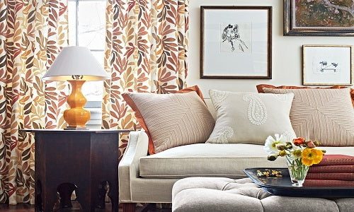 Hodsoll McKenzie Fabric, Living room with leaf pattern drapes and white couch