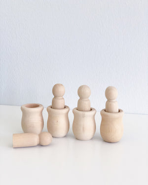 Peg dolls and cup