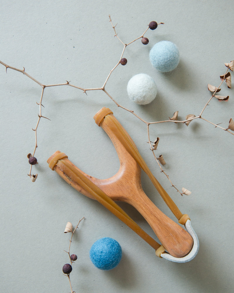 slingshot catapult wooden toy handmade felt ball vegetable dyed waldorf toy open ended toy natural materials natural colourstoys for boys