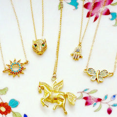 pegasus, butterfly, leopard, hamsa and sun gold and turquoise pendant neckalces