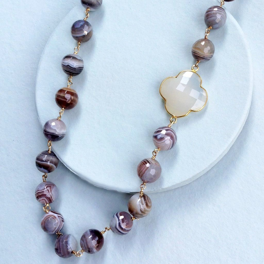 faceted milky white chalcedony clover quadrafoil pendant on botswana agate bead necklace