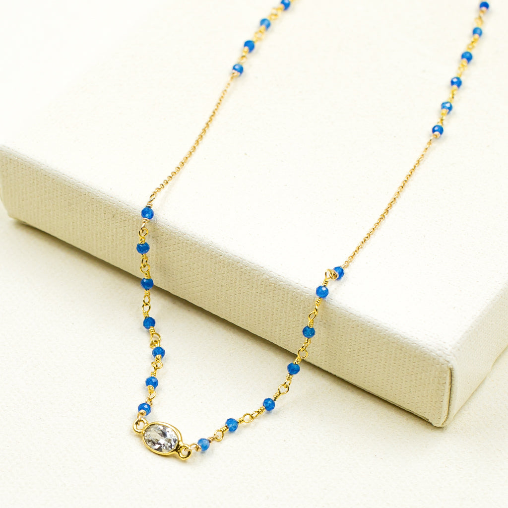 faceted blue onyx and cubic zirconia crystal on gold chain