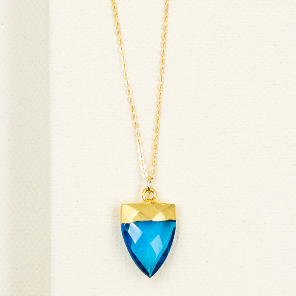 bright blue quartz crystal spear point pendant on gold filled chain necklace