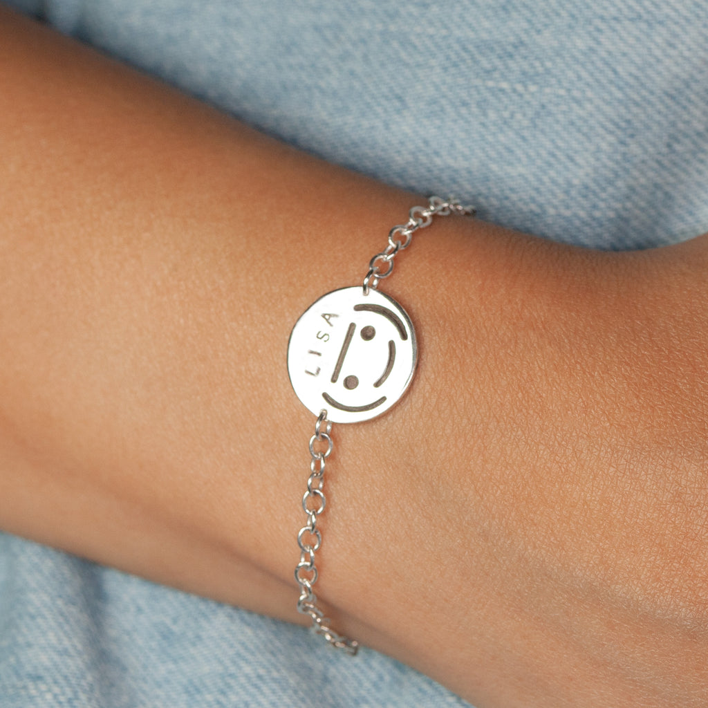 Kidzcharmz on a sterling silver bracelet.