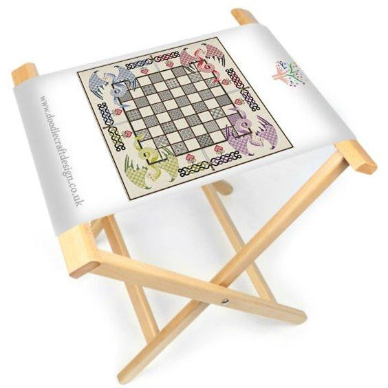 The DoodleCraft Design Dragon Chess games board printed onto canvas and made into a foldable board and stool