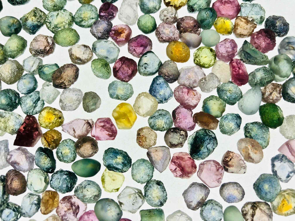 Montana Sapphires on a light table at Potentate Mine WEND Jewelry