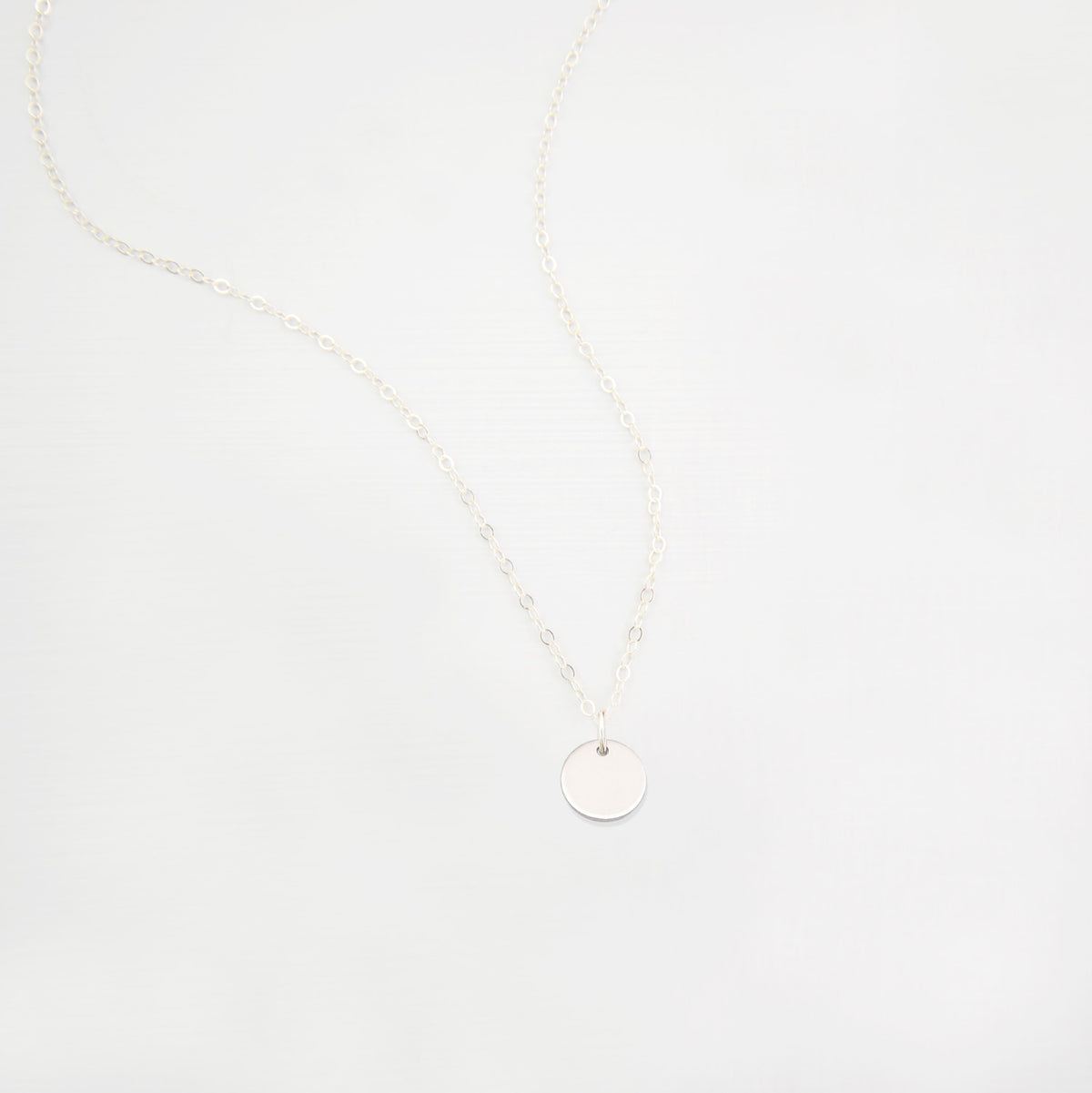 small disk necklace