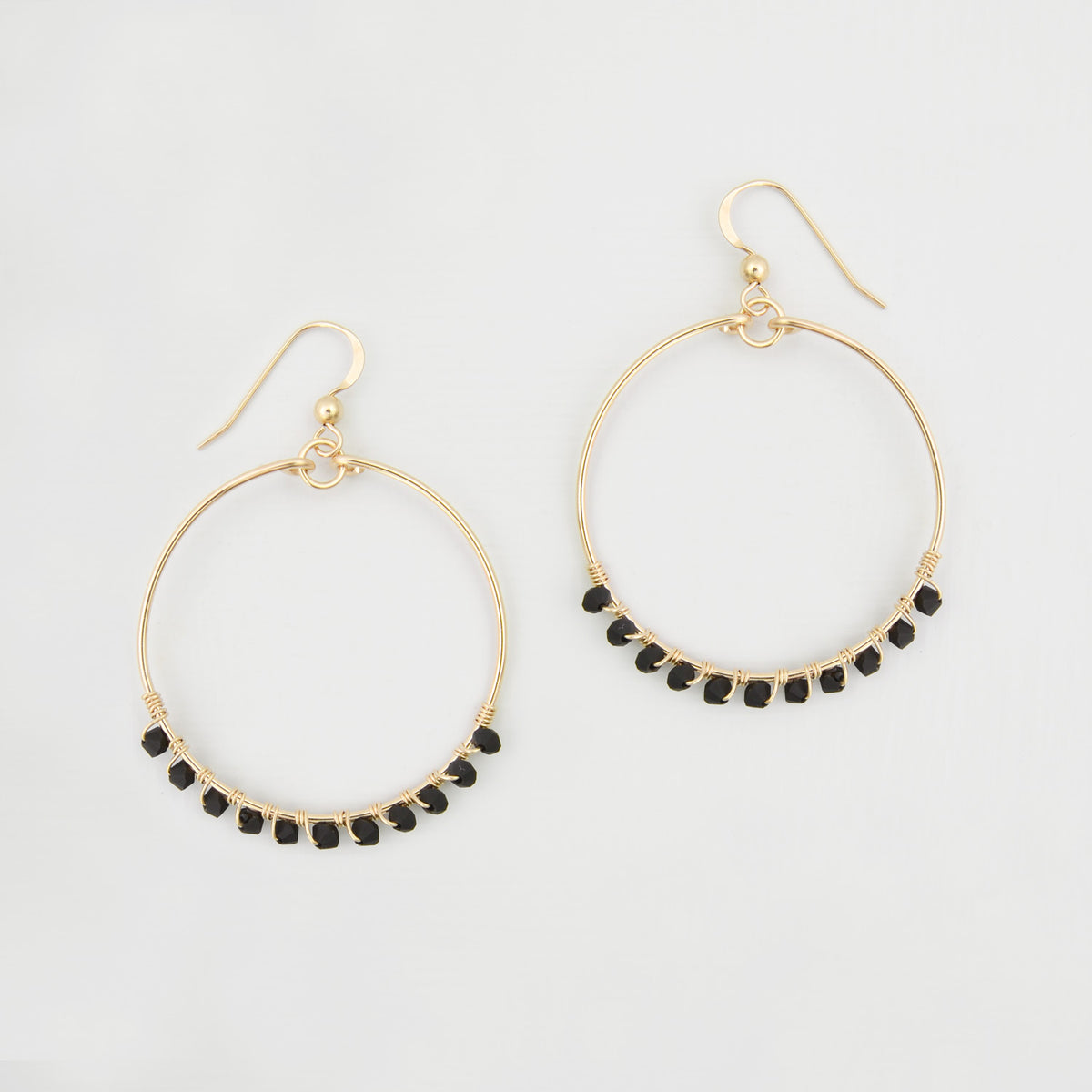 gold and black hoop earrings
