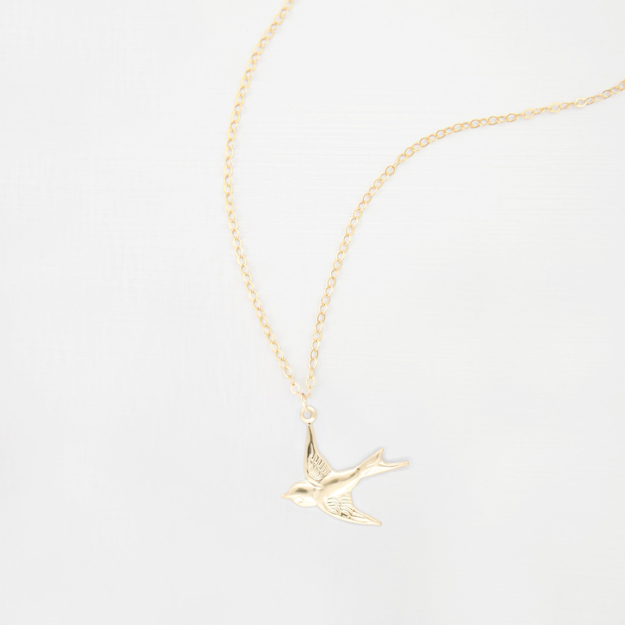 Swallow charm necklace 'Ren'