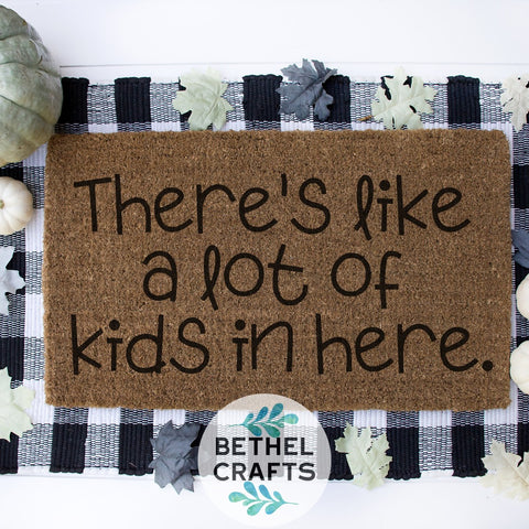 """There's Like a lot of kids in here "" Door Mat"