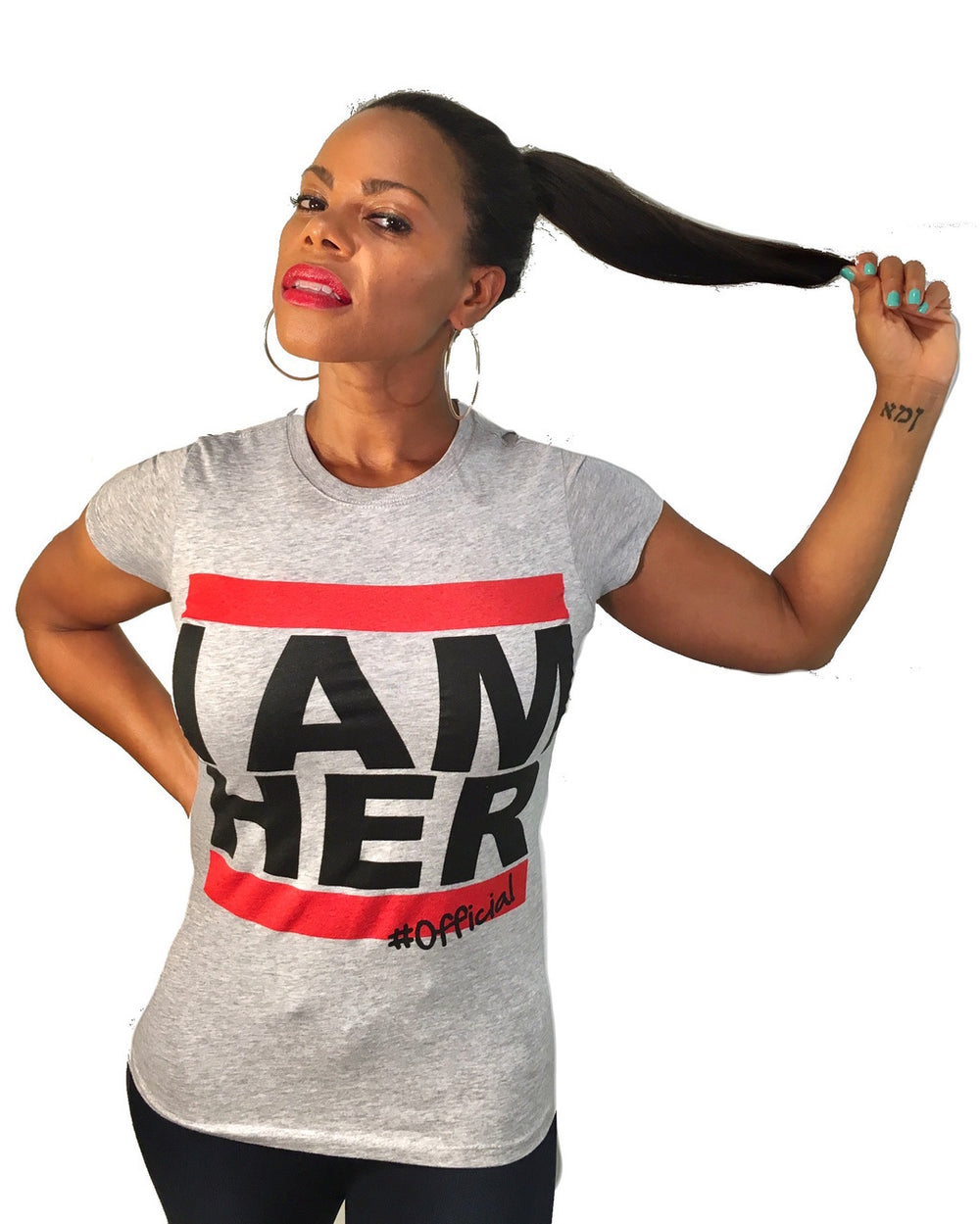 Female wearing gray Women's Graphic Tee with saying, I AM HER. Women's Tee for the girl who is unapologetically feminist and believes in girl power.