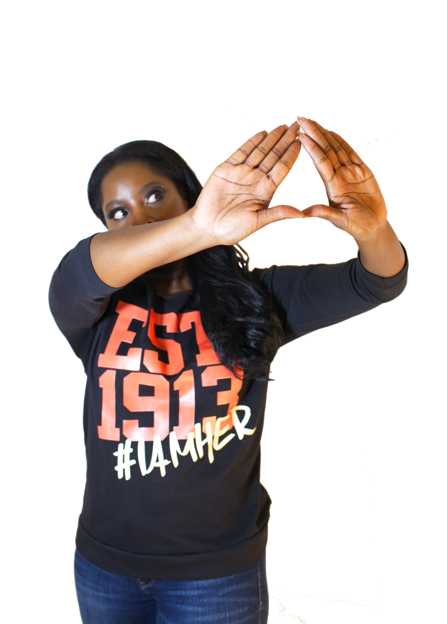 Black female wearing Black Women's Wideneck Off Shoulder with 3/4 sleeve for women with saying, EST. 1913 #IAMHER designed for the sisters of Delta Sigma Theta.