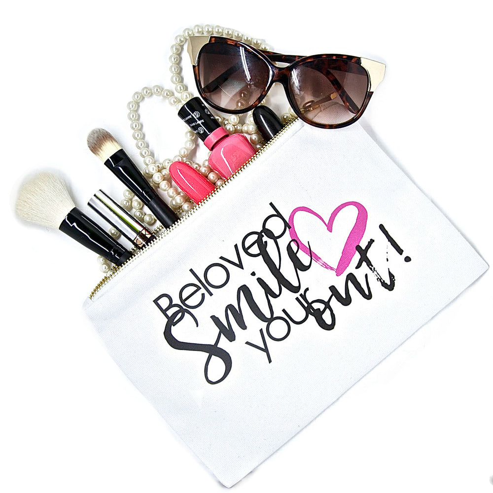 White canvas makeup bag with saying, Beloved, Smile Your Heart Out for beauty essentials to organize beauty products, cosmetics and accessories.
