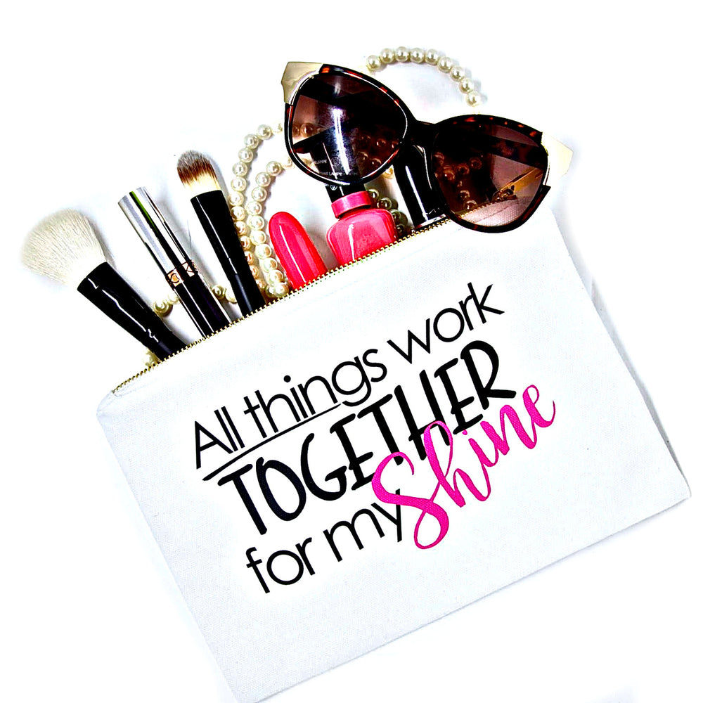 White canvas makeup bag with saying, all things work together for my shine for beauty essentials to organize beauty products, cosmetics and accessories.